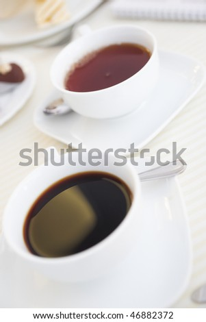 Soft-focused cup of morning black coffee and tea - stock photo