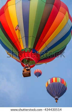 soft-focused hot-air balloons with blue sky
