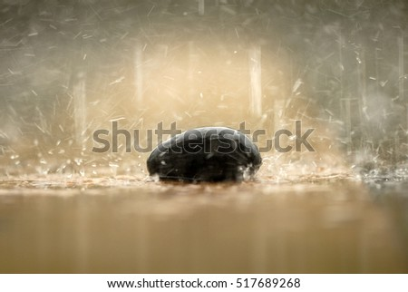 Soft focused of Zen stone, a rock in the rain