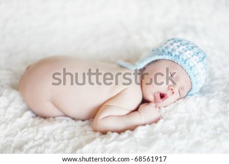 Soft-focused portrait of a newborn baby sleeping. Shallow DoF. - stock photo