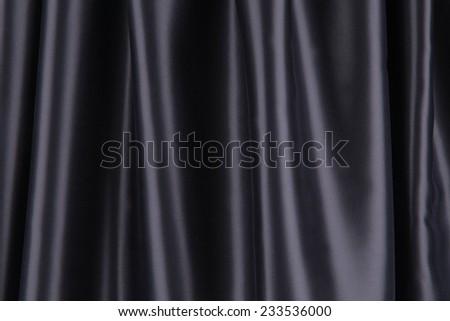Soft folds of black silk cloth. Whole background. - stock photo