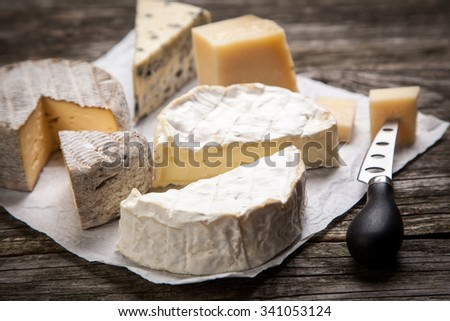 Soft french cheese of camembert and other types - stock photo