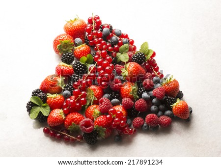 soft fruits in the shape of heart - stock photo