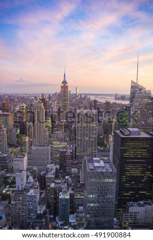 Soft golden pink sunset view of the Midtown Manhattan New York City skyline looking south