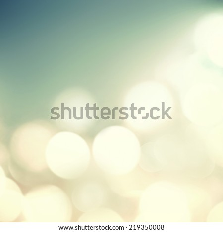 Soft light abstract background. Defocused Bokeh twinkling lights Vintage background.   - stock photo