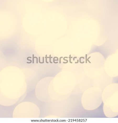 Soft light abstract background. Defocused Bokeh twinkling lights Vintage background.  Festive blur background with natural bokeh and bright golden lights.