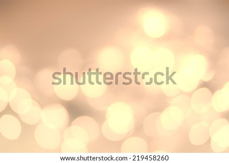 Soft light abstract background. Defocused Bokeh twinkling lights Vintage background.  Festive blur background with natural bokeh and bright golden lights.  - stock photo