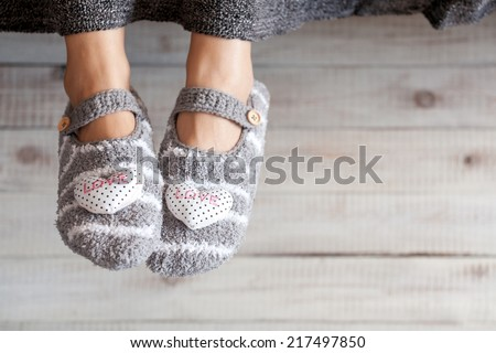 Soft photo of woman feet in cute slippers, top view point. Cozy, comfy, soft - stock photo