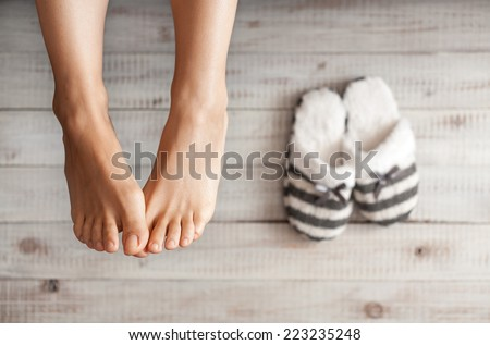 Soft photo of woman's feet with slippers, top view point. Cozy, comfy, soft - stock photo