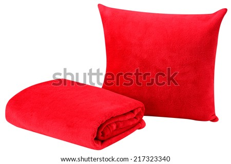 Soft pillow and blanket against white background.