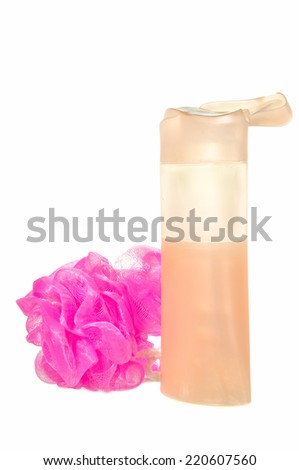 Soft pink bath puff or sponge and liquid soap isolated on white background - stock photo