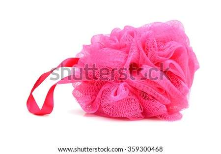 Soft pink bath puff or sponge isolated on white background with copy space.  vanity, wash, washroom, wellness, white