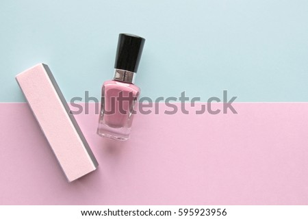 Soft Pink Nail Polish And Buffer Block Two Tone Background