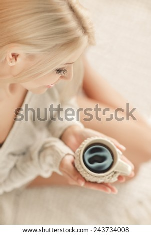 Soft portrait of teenage girl drinking hot coffee at home, instagram style toned. Young beautiful woman in warm knitted handmade clothes at home. Autumn, winter season. Cozy, comfy, soft - stock photo