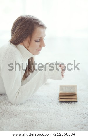 Soft portrait of teenage girl reading book at home