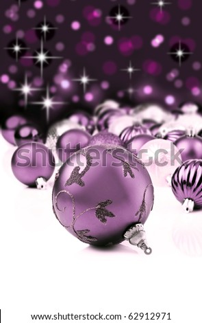 Soft purple christmas ornaments with star background - stock photo