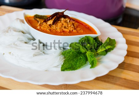 Soft rice noodle with hot and  spicy red curry, chicken  - stock photo