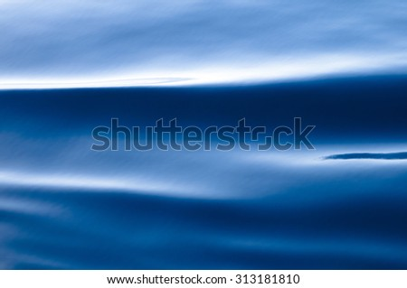 Soft rolling Deep Blue waves on water surface-Background - stock photo