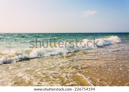 Soft Sea Ocean Waves Wash Over Sand Background. Toned Instant Photo - stock photo