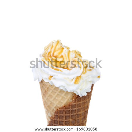 Soft serve ice cream. Topping caramel. Isolated on a white background.