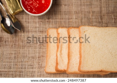 soft sliced bread with jam and butter