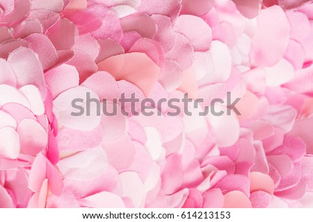 Soft spring pink textile petals background. Flower blossom wallpaper, top view