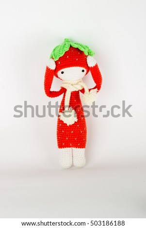 soft toy crochet a red strawberry in a white cap and scarf