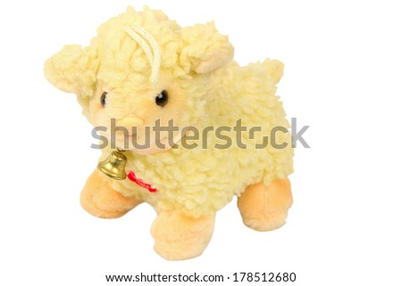 soft toy lamb with a bell - stock photo
