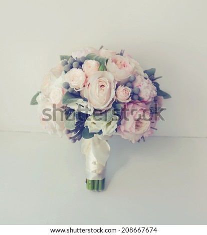 Soft vintage photo gentle wedding bouquet - stock photo