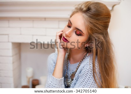 Soft warm clothes.soft image,grey sweater,Beautiful Fashion Luxury Makeup,long eyelashes,perfect skin facial make-up.Beauty Brunette model woman holiday make up close up.Eyelash extensions,eyelashes - stock photo