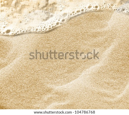 Soft wave of the sea on the clean sandy beach. - stock photo