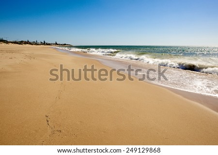 Soft wave of the sea on the sandy summer beach - stock photo