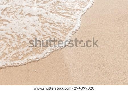 Soft wave on sandy beach - stock photo