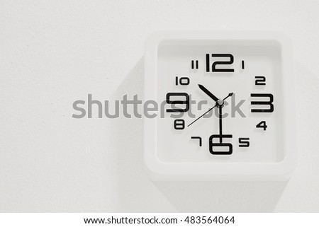 soft white clock on white wall background
