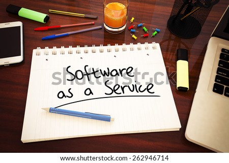 Software as a Service - handwritten text in a notebook on a desk - 3d render illustration. - stock photo