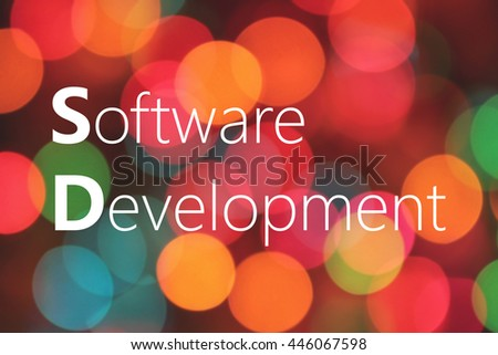 Software Development text on colorful bokeh background - stock photo