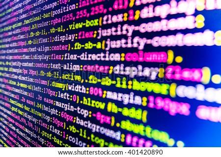 Software development.  Web site codes on computer monitor. Computer program. Developer working on websites codes in office. Website programming code. Programmer occupation.   - stock photo