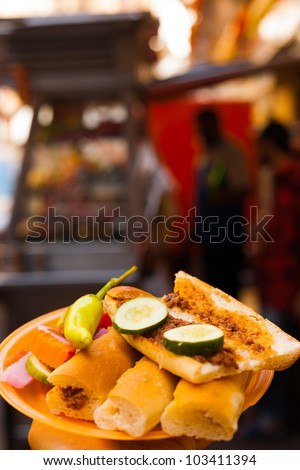 Sogo, a traditional Egyptian street food sandwich is served from food carts with pickles and a sausage meat - stock photo