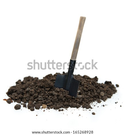 Soil and shovel on white - stock photo