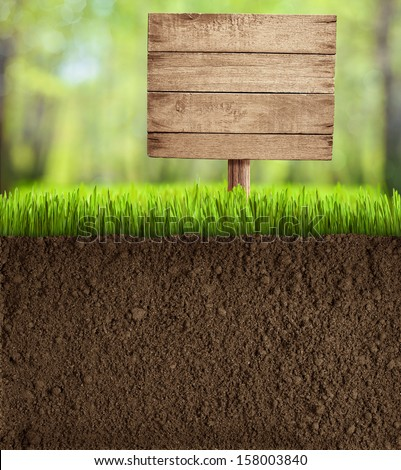soil cut in garden with wooden sign - stock photo