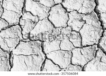soil drought cracked texture. Black and white High contrast - stock photo