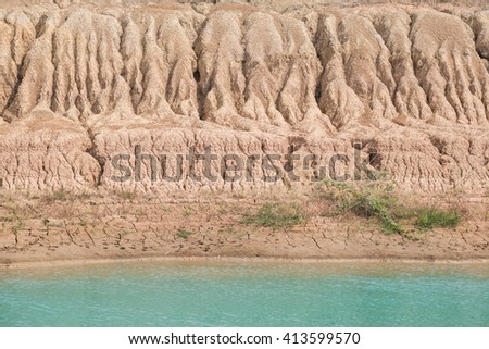 soil erosion with lake - stock photo