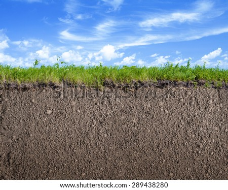 Soil ground, grass and sky nature background - stock photo
