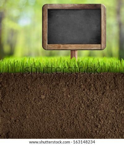 soil in garden with blackboard sign - stock photo