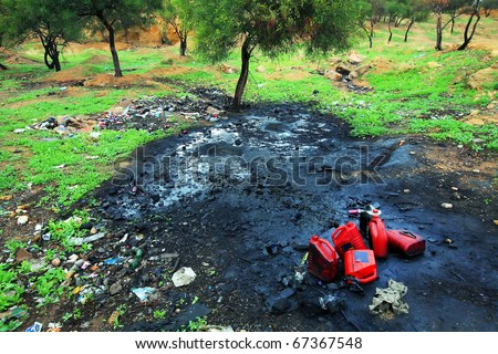 Soil pollution with petrochemical products - stock photo