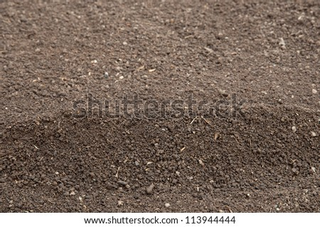 Soil- selective focus on the top of the heap - stock photo