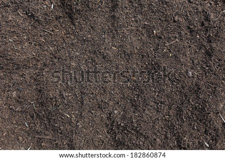 Soil surface background, manure compost prepared for a farmland - stock photo