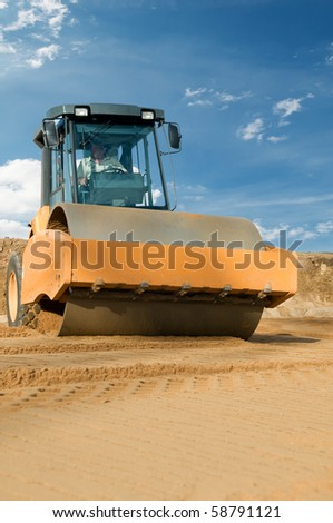 soil vibration roller during sand compacting works at construction road site