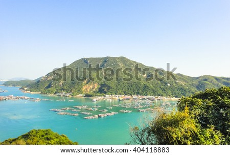 Sok Kwu Wan bay and pier. Southern part of Lamma island in Hong Kong. View from the hill in the daytime