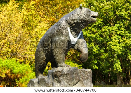 SOKCHO, KOREA - OCTOBER 10, 2015 : Seoraksan National park, statue bear a sign at the entrance, holiday people Korean popular walking for health. place of natural beauty and always travel as a family. - stock photo